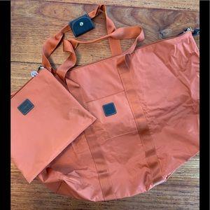 Bric's burnt orange duffle with detachable pouch